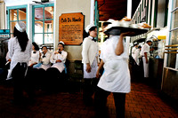 A waitress yawns at a busy Café du Monde in the New Orleans French Quarter.